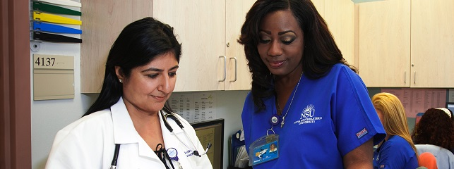Dr. Bhasin consults with team about patient care