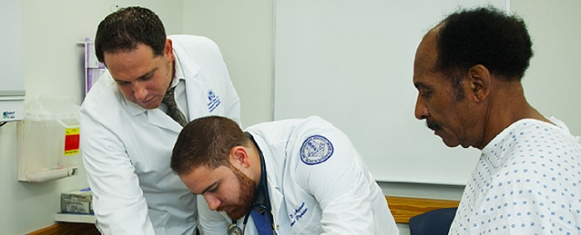 Dr. Darren Cohen demonstrates a patient examination to osteopathic medical student