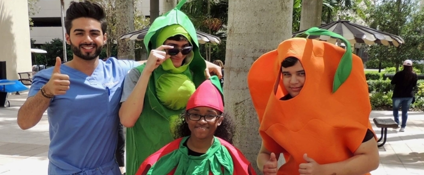 students in fruit/veggie costumes